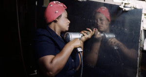 """A """"Rosie"""" working on the A-31 Vengeance bomber in Nashville, Tennessee (1943)"""