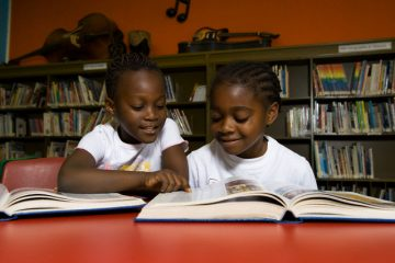 Students in School Library --- Image by © Brian Summers/First Light/Corbis